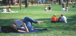 Student_studying_on_lawn_